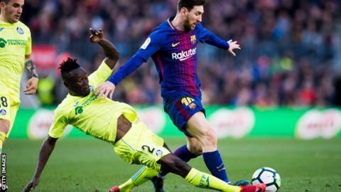 Togo's Dakonam Djene tackles Lionel Messi