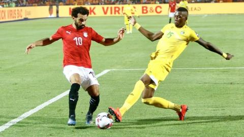 Teenage Hadebe (right) in action against Egypt's Mohamed Salah at the Africa Cup of Nations in Egypt