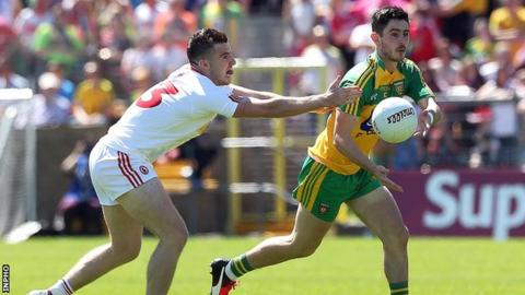 Connor McAliskey challenges Ryan McHugh for possession during the first half