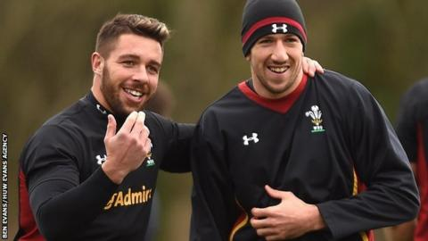 Rhys Webb (l) drapes his arm over Justin Tipuric as the pair share a joke during a Wales training session