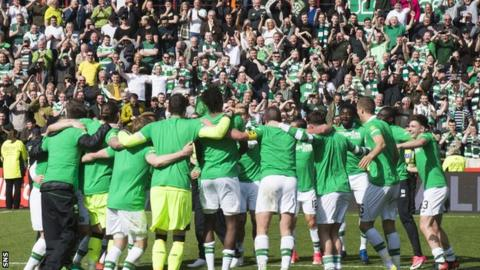 The Celtic players celebrate with their fans after sealing the title on Sunday at Tynecastle