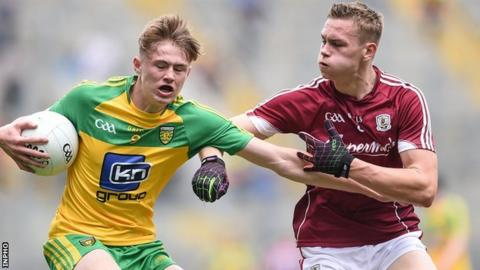 Donegal's Kieran Gallagher is challenged by Donegal opponent Sean Rafferty in the semi-final