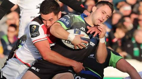 Toulouse's Carl Axtens tries to dispossess Connacht's Caolin Blade