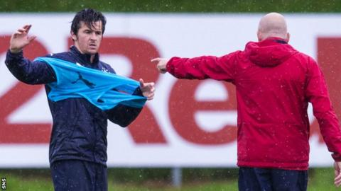 Joey Barton (left) and Rangers manager Mark Warburton