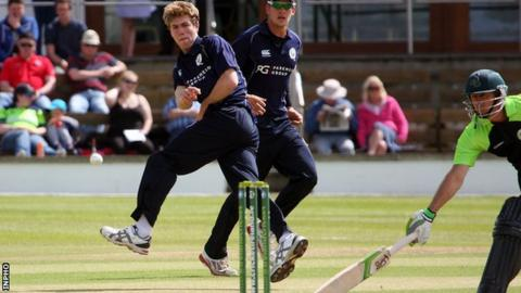 Scotland's Gavin Main attempts to get a run out in an international T20 game against Ireland in 2015