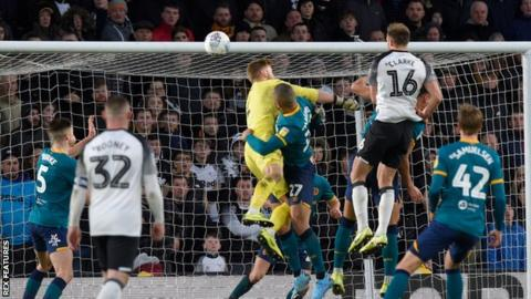 Matt Clarke heads in a goal for Derby against Hull