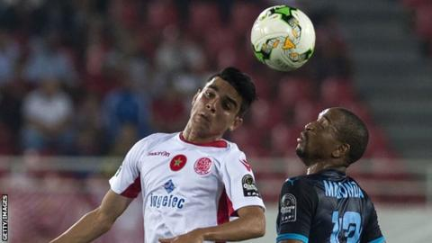Mamelodi Sundowns and Wydad Casablanca players challenge for a header
