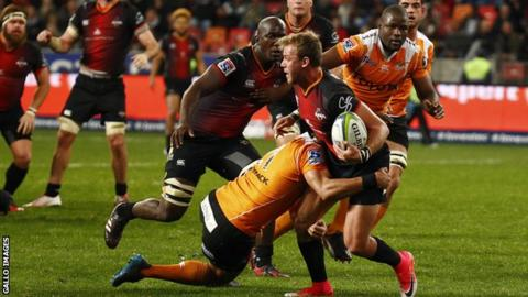 Southern Kings' Rudi van Rooyen is tackled during a match against Cheetahs