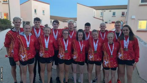 The Isle of Man swimming team show off their medals from the Island Games
