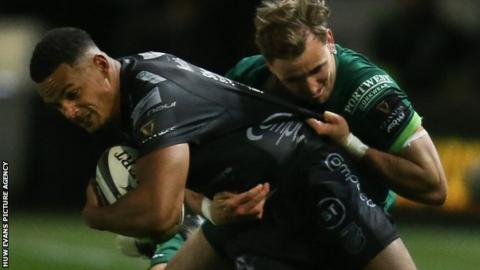 Ashton Hewitt of Dragons is tackled by John Porch