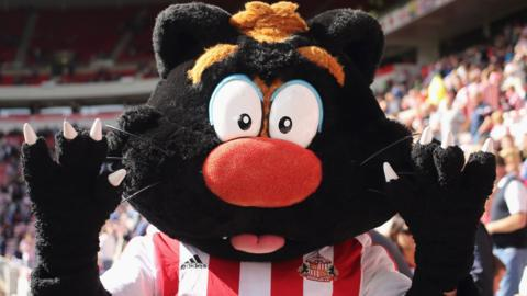 Sunderland's mascot poses for a photo