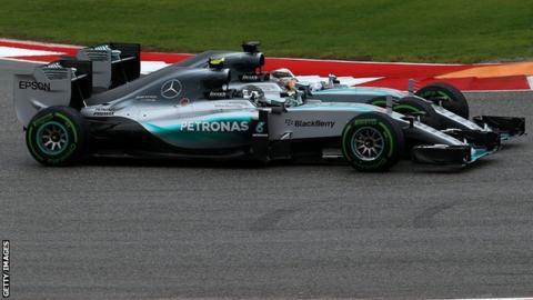 Lewis Hamilton and Nico Rosberg racing side by side