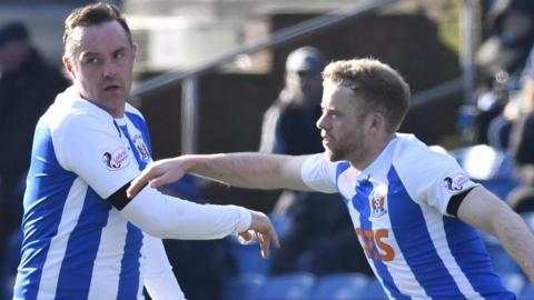 Rory McKenzie congratulates Kris Boyd on his equaliser