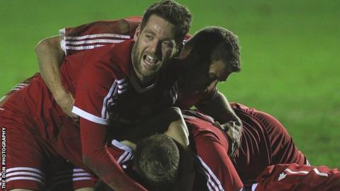 Denbigh Town players celebrate the semi-final win over GAP Connah's Quay