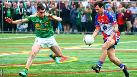 New York's Jamie Clarke tries to find a way past Leitrim's Paddy Maguire at Gaelic Park