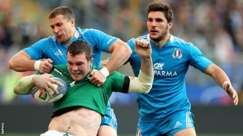 Peter O'Mahony is captained by Tommaso Benvenuti during the 2013 game in Rome
