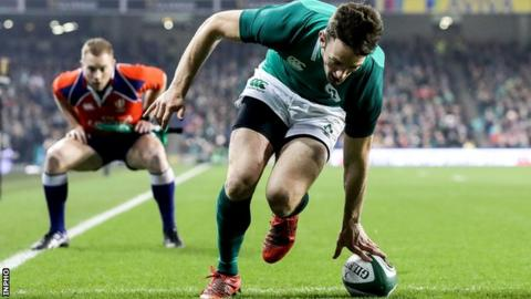 Munster wing Darren Sweetnam dots down Ireland's opening try against Fiji
