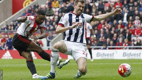 Jermain Defoe gets a shot away under pressure from Gareth McAuley