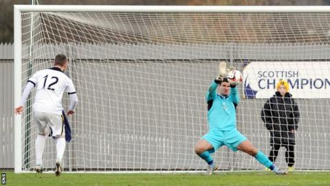 Dundee goalkeeper Kyle Letheren saves Bryan Prunty's penalty for Dumbarton