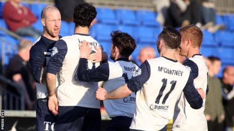 Ballinamallard players run to congratulate Stephen O'Flynn after the striker scored the opening goal