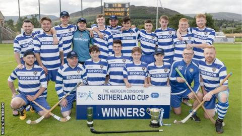 Newtonmore players with the Sutherland Cup