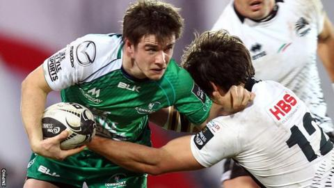 Connacht's AJ MacGinty in action against Matteo Pratichetti of Zebre