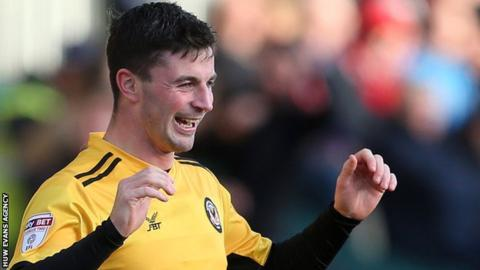 Padraig Amond celebrates his goal against Exeter
