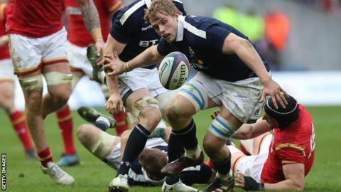 Scotland lock Jonny Gray contests the ball against Wales