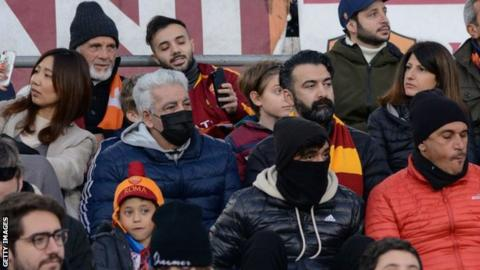 Roma fans take coronavirus precautions