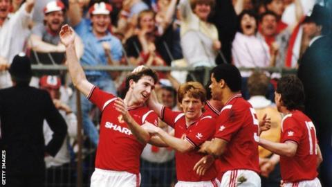 Norman Whiteside celebrates scoring the extra-time winner against Everton in the 1985 final