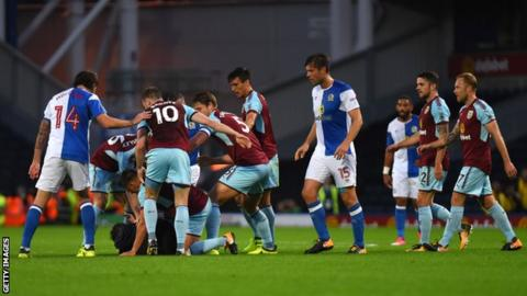 A spectator confronts Burnley players at Ewood Park