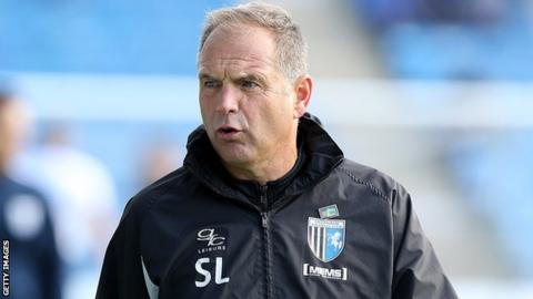 Gillingham boss Steve Lovell looks on from the sidelines