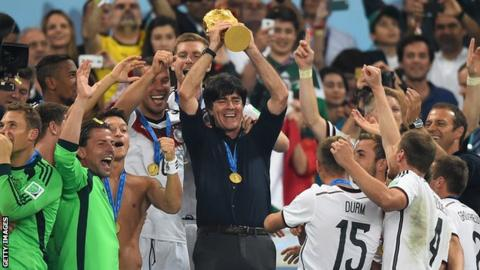 Germany coach Joachim Low lifts the 2014 World Cup