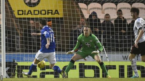Stephen Dobbie steals in to score his 17th goal of the season
