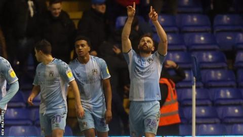 Matt Godden headed his 13th goal of the season to keep Coventry are level on points with Rotherham at the top of League One