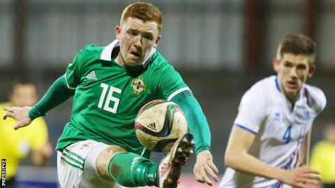 Shayne Lavery (left) in action for the Northern Ireland Under-21s against Iceland last March