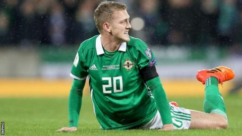 George Saville shows his frustration during Northern Ireland's World Cup play-offs defeat by Switzerland last November