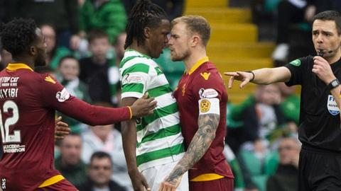 Celtic's Dedryck Boyata and Motherwell's Richard Tait exchange words after Motherwell pull a goal back