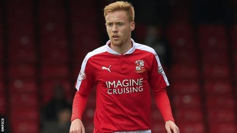 Swindon Town midfielder James Brophy