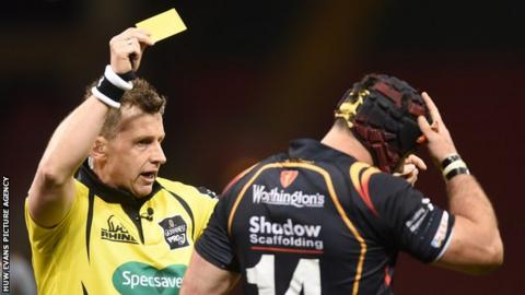 Referee Nigel Owens shows a yellow card during an Ospreys game