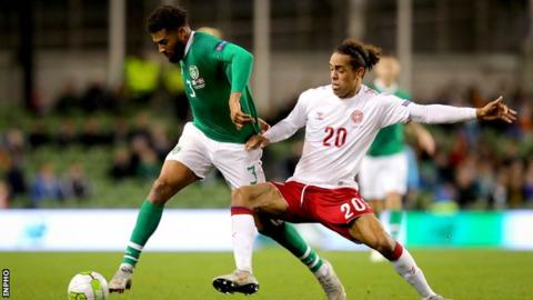 Cyrus Christie attempts to get past Denmark's Yussuf Poulson in Dublin