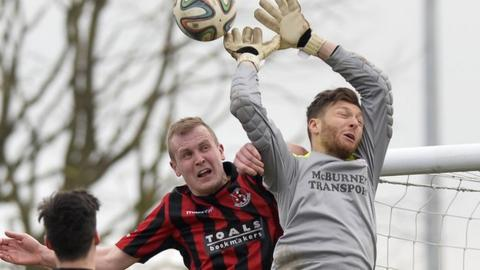 Crusaders striker Jordan Owens challenges Ballymena keeper Tim Allen two years ago