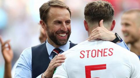 England boss Gareth Southgat with defender John Stones