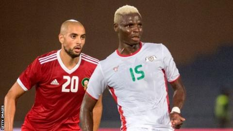 Aristide Bance (right) in action for Burkina Faso against Morocco