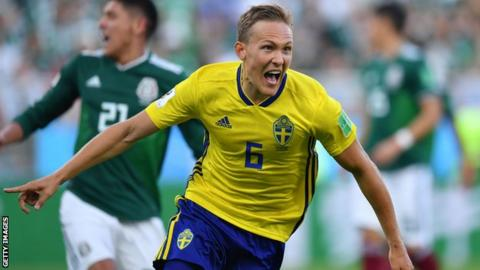 Deflected Emil Forsberg strike sends Sweden into quarter-finals