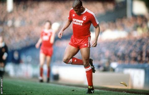 Liverpool's John Barnes backheels a banana that was thrown onto the pitch during a game at Everton in 1988