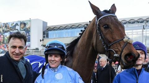 Rachael Blackmore with trainer Henry de Bromhead after Honeysuckle's Irish Champion Hurdle win at Leopardstown