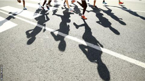 Shadow of athletes running