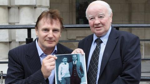 Freddie Gilroy (right) with actor Liam Neeson in 2010, holding a picture of them together in Ballymena 48 years earlier