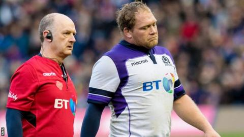 WP Nel departs the action against Samoa, accompanied by Scotland team doctor James Robson